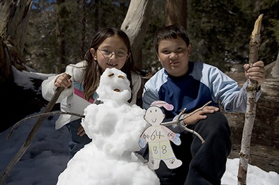 Flat Stanley Building Snowmen in the Desert